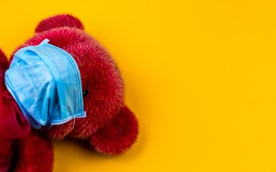 red bear plush toy on yellow surface